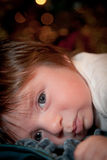 Baby Bed Time. A baby with a cute expression and pouty lips laying down. The image has a vertical orientation and copy space Stock Images
