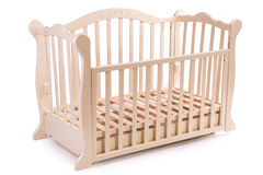 Baby bed wooden on a white background Royalty Free Stock Images