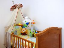 Baby bedroom. Bedroom with bed and toys for the baby Stock Photo