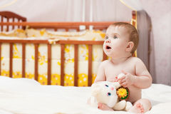 Baby in bedroom Stock Images