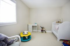 Baby bedroom. With toys and stroller Royalty Free Stock Photos