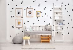 Baby bedroom decorated with pictures. Of animals stock photos