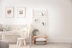 Baby bedroom decorated with pictures. Of animals Stock Image