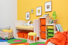 Baby bedroom with pictures of animals. On wall royalty free stock images