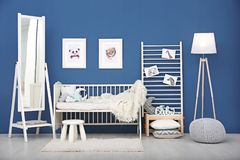 Baby bedroom with pictures of animals. On wall stock images