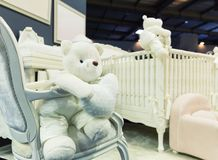 Baby bedroom with white teddy bear Stock Photo