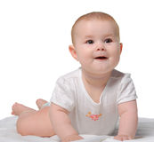 The baby on a bedsheet Royalty Free Stock Photos