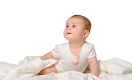 The baby on a bedsheet Stock Image