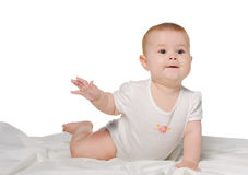 The baby on a bedsheet Royalty Free Stock Image