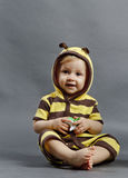 Baby bee. Smiling baby wearing a bumble bee costume Stock Photo