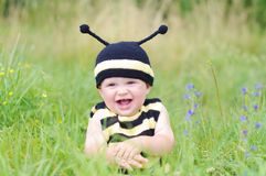Baby in bee costume on the meadow. Baby age of 10 months in bee costume on the meadow Royalty Free Stock Photos