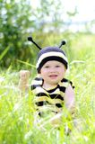 Baby in bee costume outdoors. Baby age of 10 months in bee costume outdoors Royalty Free Stock Image