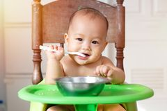 Baby first meal Stock Photos