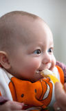 A baby being fed Stock Photos