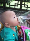 Baby being fed Stock Images