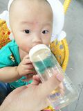 Baby being fed. Baby boy being fed by adult royalty free stock photo