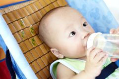 Baby being fed Stock Photos