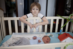 Baby being held tenderly by big brother Stock Photo