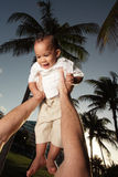 Baby being held up Royalty Free Stock Photo