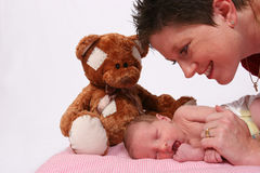 Baby being watch by loving mother Stock Photography