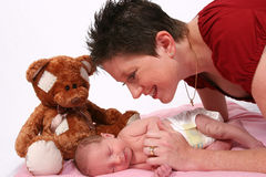 Baby being watch by loving mother Royalty Free Stock Photos