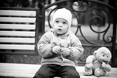 Baby on the bench Royalty Free Stock Photography