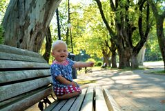 Baby on a bench Royalty Free Stock Images