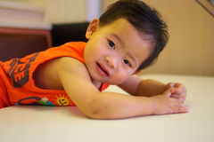 A baby bend over the table Royalty Free Stock Image