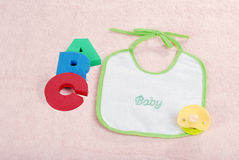 Baby bib with A B C letters Stock Photo