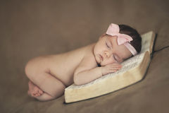 Baby on Bible Stock Images