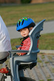 Baby in bicycle chair Royalty Free Stock Images