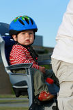Baby in bicycle chair Royalty Free Stock Image