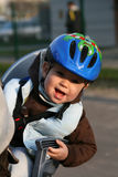 Baby in bicycle chair Stock Photos