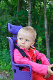 Baby on bicycle seat Royalty Free Stock Image