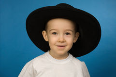 Baby in a big black hat Royalty Free Stock Photos