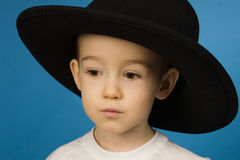 Baby in a big black hat Royalty Free Stock Image