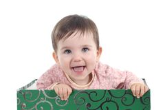 Baby with a big blue eyes looking up and laughing Stock Image