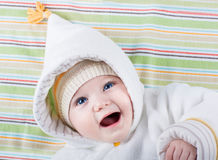 Baby with big blue eyes in warm hat and jacket Royalty Free Stock Images