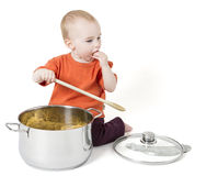 Baby with big cooking pot Stock Images