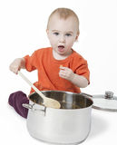 Baby with big cooking pot. On white background Royalty Free Stock Photos
