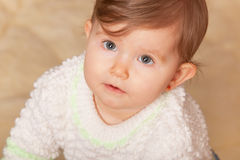 Baby with big grey eyes Stock Images