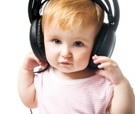 Baby in big headphones Stock Photo