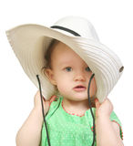 Baby in a big white hat. Baby girl in a big white hat Stock Images
