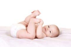 Baby bij bed stock afbeeldingen
