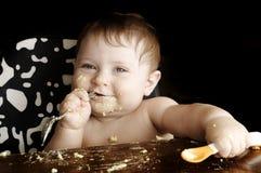 Baby bij maaltijd Stock Foto