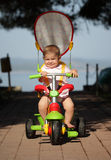 Baby on bike Stock Photos