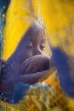 Baby Bilum. Baby sleeping in a bilum string bag hamock in papua new guinea Stock Photo