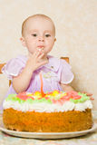 Baby with the birthday cake. Royalty Free Stock Photography