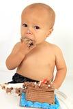 Baby and birthday cake.