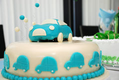 Baby boy blue birthday cake with car Stock Image